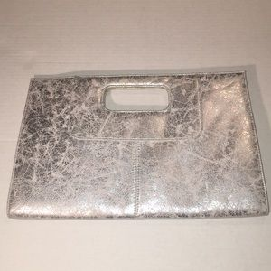 Silver metallic like handheld clutch purse